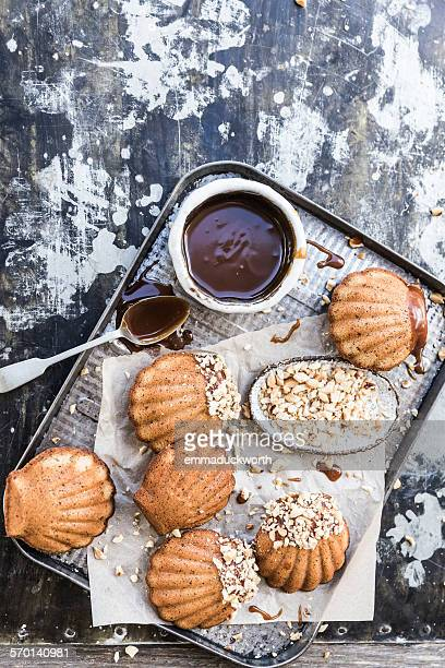 Hazelnut madeleines with caramel sauce on a cooling rack