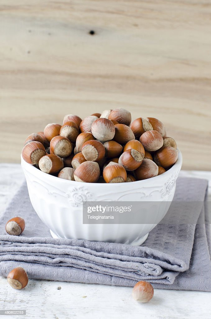Hazelnuts in a bowl : Stock Photo