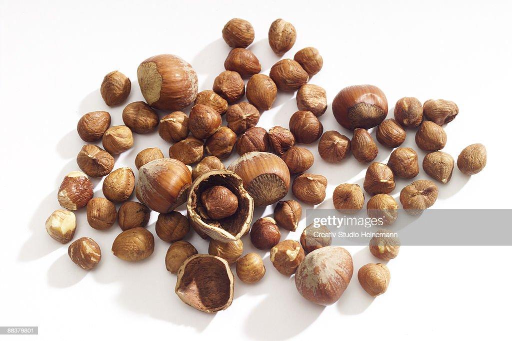 Hazelnuts on white background, close-up