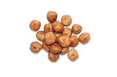 Peeled hazelnuts isolated on white background. Top view point.