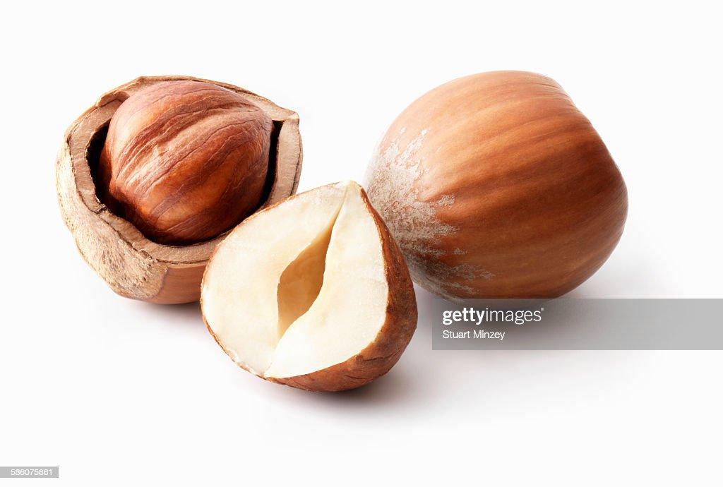 Hazelnuts whole, open and half