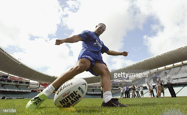 Hazem El Masri of the Bulldogs kicks a goal while Mark Riddell of the Saints and Craig Fitzgibbon of the Roosters watch during the launch of the Xbox...