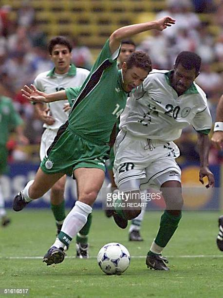 Hazem Emam of Egypt fights for the ball with Mohsin Harthi of Saudi Arabia 29 July 1999 during Confederation Cup soccer in Mexico City AFP...