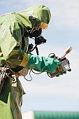 HazMat firefighter taking radiation reading