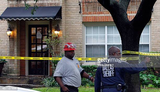 A hazmat worker receives instruction for a Dallas County sheriff in front of the apartment where a second person diagnosed with the Ebola virus...