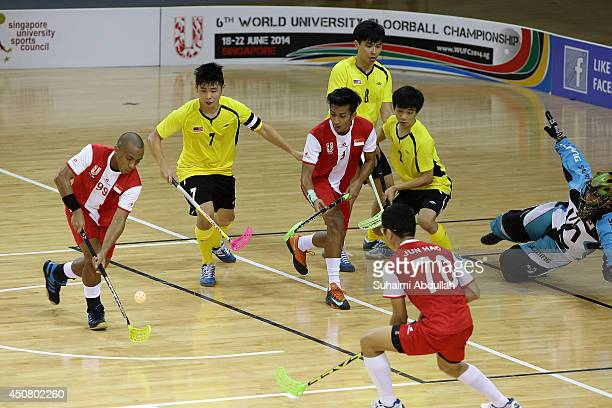 Hazmi Hasan of Singapore lines up a shot at goal during the World University Championship Floorball match between Malaysia and Singapore at the...