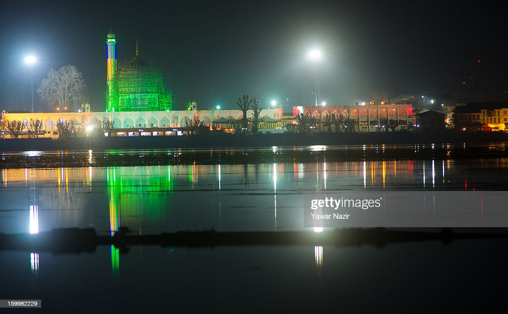 Hazratbal shrine is illuminated and reflected on the waters of Dal lake on the eve of Eid-e-Milad, the birth anniversary of Prophet Mohammed on January 24, 2012 in Srinagar, the summer capital of Indian administered Kashmir, India. Thousands of Muslims from different parts of Kashmir visit the Hazratbal shrine in Srinagar to pay obeisance at the revered shrine, believed to house a holy relic of the Prophet, and many participate in 'Shab-khwani' or nightlong prayers on the eve of Eid-e-Milad.