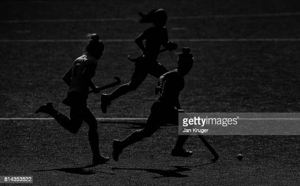 Hazuki Nagai of Japan and Amelia Katerla of Poland battle for possession during day 4 of the FIH Hockey World League Semi Finals Pool B match between...