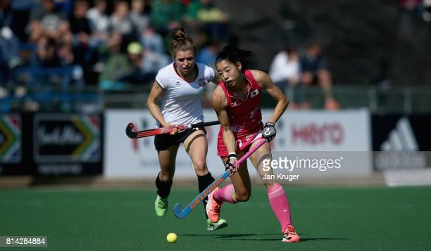 Hazuki Yuda of Japan and Amelia Katerla of Poland battle for possession during day 4 of the FIH Hockey World League Semi Finals Pool B match between...