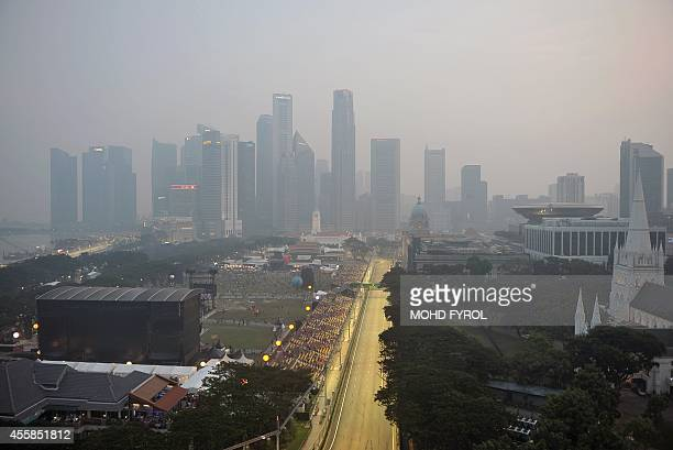 Hazy conditions cover the Marina Bay Circuit during the driver's parade before the start of the Singapore Formula One Grand Prix in Singapore on...