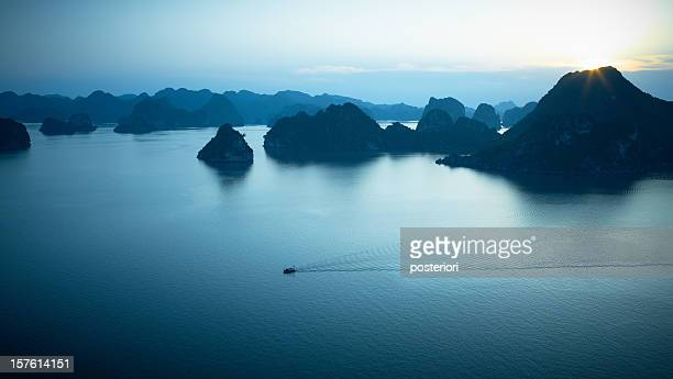 Hazy islands at dawn in Halong Bay, Vietnam