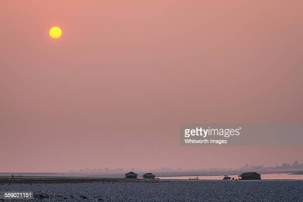 Hazy pink sunset over Koshi River in east Nepal
