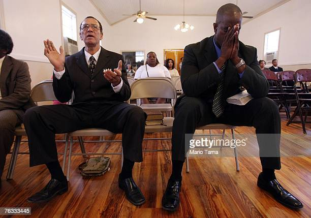 Hazzert Gillett sings as another worshiper prays during services at Greater Little Zion Missionary Baptist Church which was founded in 1900 in the...