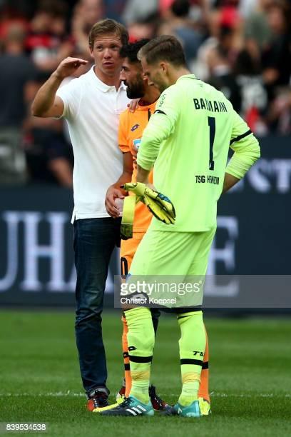 hc Julian Nagelsmann of Hoffenheim speaks to Krem Demirbay and Oliver Baumann of Hoffenheim after the Bundesliga match between Bayer 04 Leverkusen...