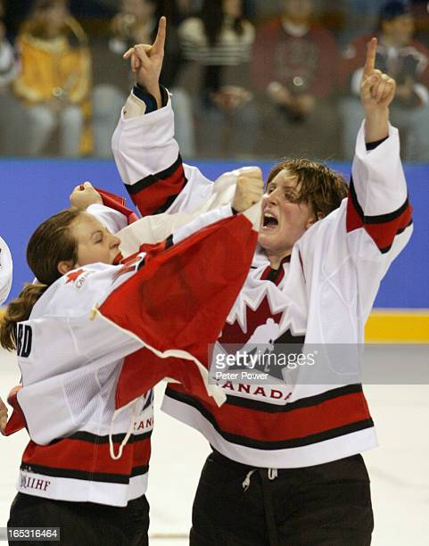 Team Canada's Jayna Hefford and Hayley Wickenheiser celebrate their gold medal victory over Team USA in women's hockey at the Olympic Winter Games in...