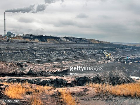 hdr open Strip Coal mine with smoke stake fumes