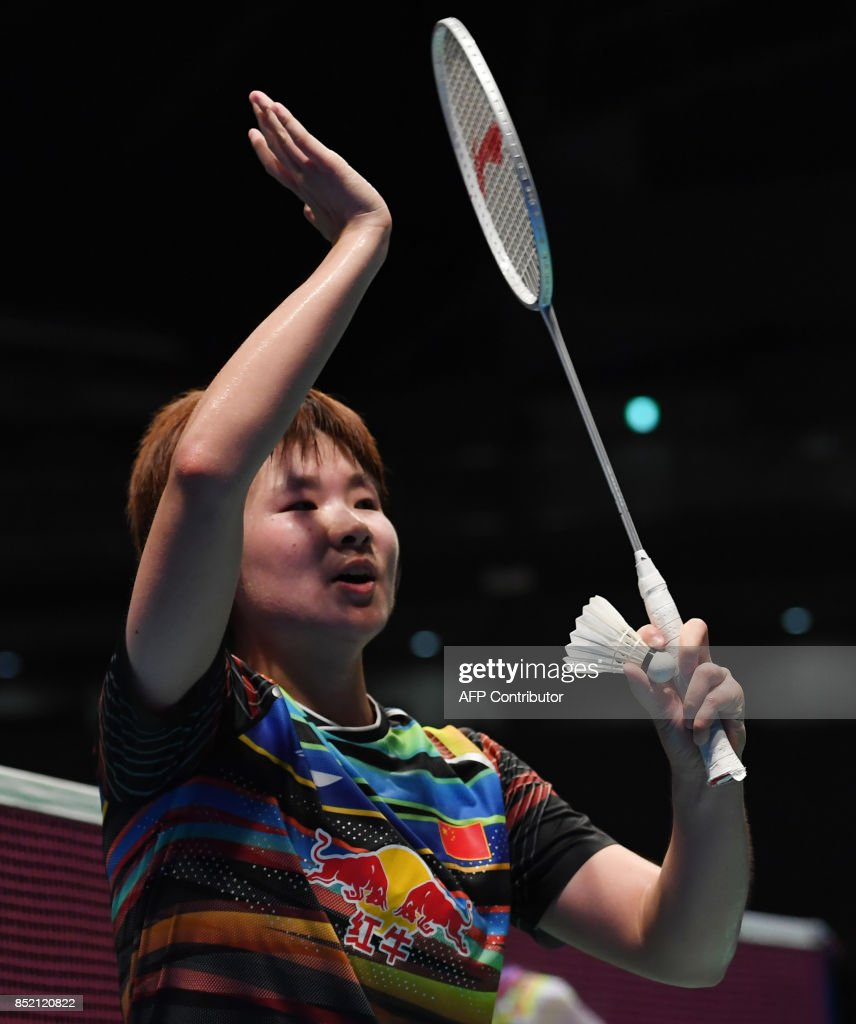 He Bingjiao of China celebrates her victory against Chen Yufei of
