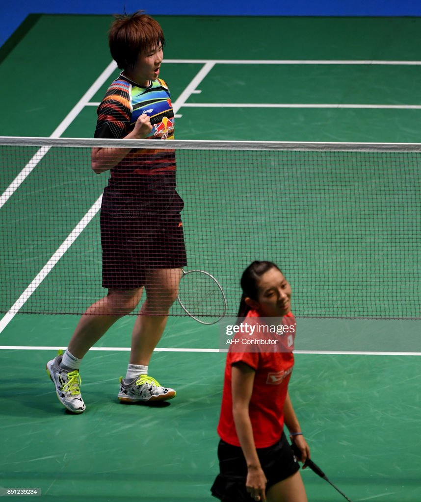 He Bingjiao of China top celebrates winning the second set