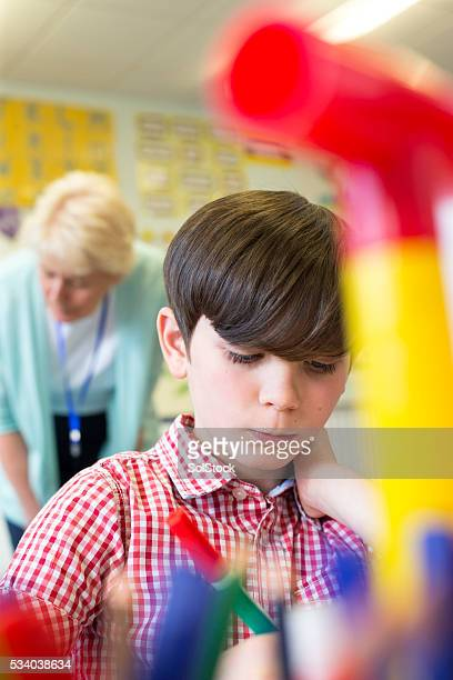 He is concentrating on his classwork