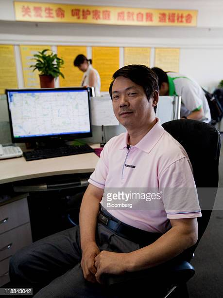 He Jin founder of Beijing Ben Ao An Da Automobile Driving Service Co poses for a portrait at the company's office in Beijing China on Saturday July 9...