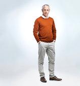 A studio portrait of a casual mature man