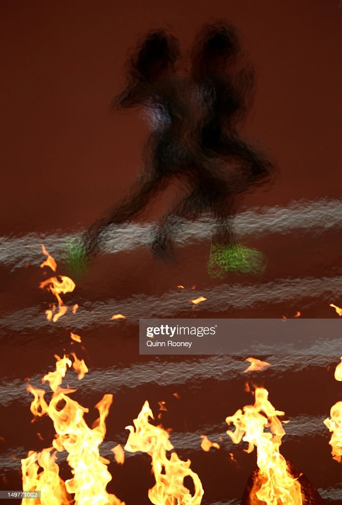 he Olympic Cauldron burns as athletes compete in the Women's 10,000m Final on Day 7 of the London 2012 Olympic Games at Olympic Stadium on August 3, 2012 in London, England.