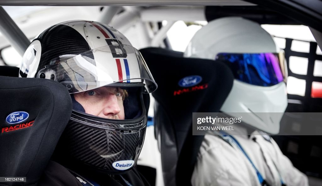 he Stig, character of the British television show Top Gear, and Dutch Prince Bernhard (L) pose at the racing circuit in Zandvoort on February 19, 2013 for a foretaste of the Top Gear Live event in the Amsterdam Ziggo Dome scheduled for April 27, 2013. AFP PHOTO / ANP - KOEN VAN WEEL = netherlands out