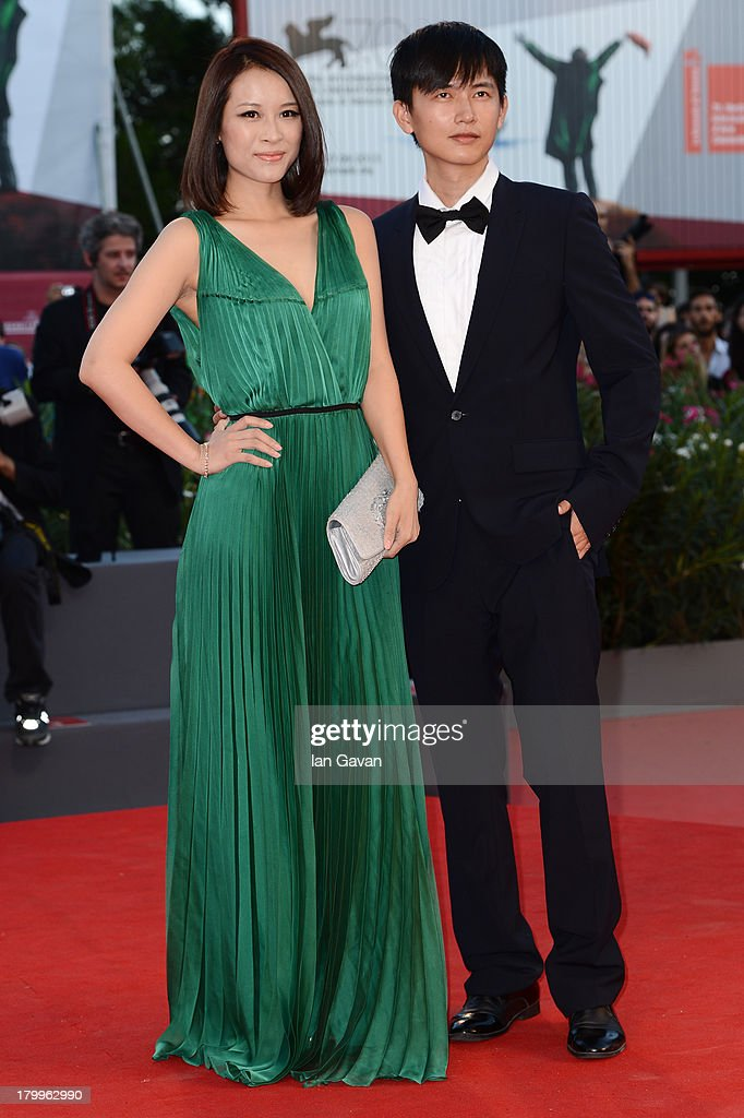 He Wenchao and Lu Yulai attend the Closing Ceremony during the 70th Venice International Film Festival at the Palazzo del Cinema on September 7, 2013 in Venice, Italy.