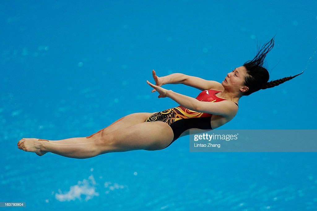 <a gi-track='captionPersonalityLinkClicked' href=/galleries/search?phrase=He+Zi&family=editorial&specificpeople=4074659 ng-click='$event.stopPropagation()'>He Zi</a> of China competes in the Women's 3m springboard final during the day two of the FINA Diving World Series Beijing Station at the National Aquatics Center on March 16, 2013 in Beijing, China.