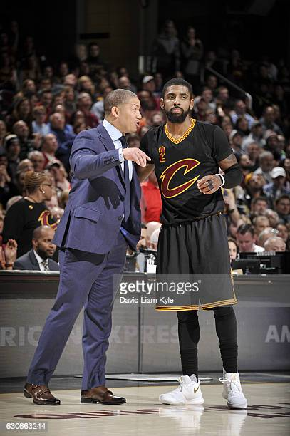 Heac Coach Tyronn Lue of the Cleveland Cavaliers gives instructions to Kyrie Irving during a game against the Boston Celtics on December 29 2016 at...