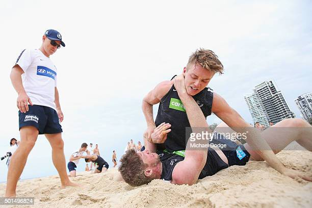 Heach coach Brendon Bolton watches Patrick Cripps pin down Sam Rowe in a wrestle during a circuit training session at Kurrawa Beach during the...