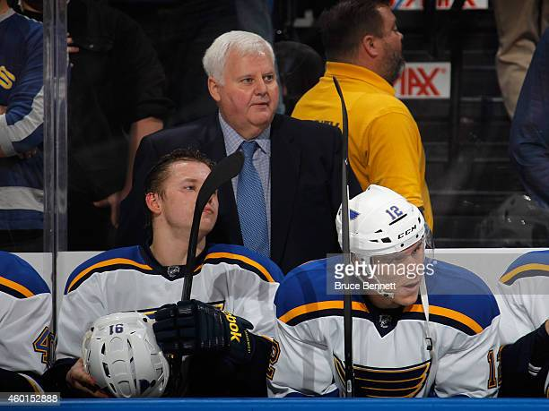 Heach coach Ken Hitchcock of the St Louis Blues handles bench duties against the New York Islanders at the Nassau Veterans Memorial Coliseum on...