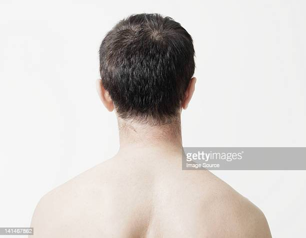 Head and shoulders of man, rear view