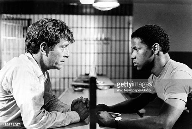 A head and shoulders portrait of actors Denzel Washington and George Segal a movie still from 'Carbon Copy' about a white man's relationship with his...