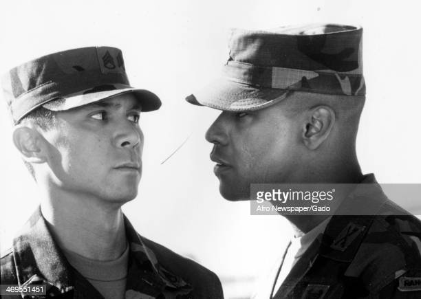 A head and shoulders portrait of actors Denzel Washington and Lou Diamond Phillips a movie still from 'Courage under Fire' about a US Army officer...