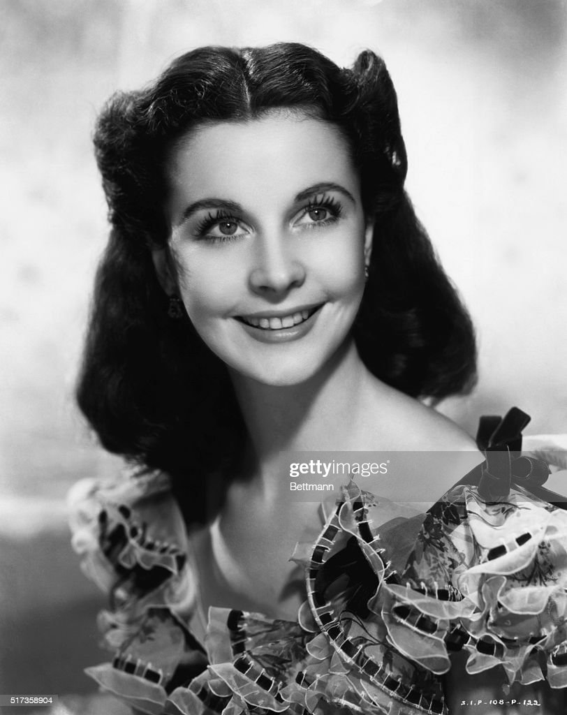 Head and shoulders portrait of British actress Vivien Leigh, wearing ruffles and ribbons. Undated photograph.