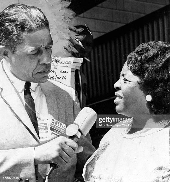 A head and shoulders portrait of civil rights leader Fannie Lou Harmer being interviewed by an ABC reporter 1965