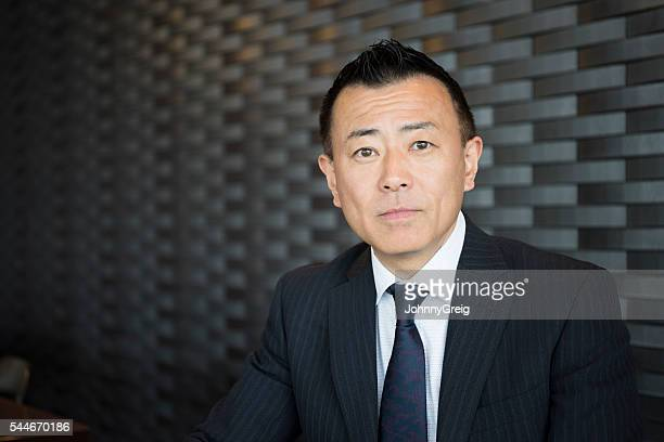 Head and shoulders portrait of Japanese businessman