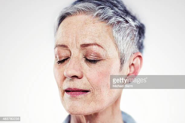 Head and shoulders portrait of mature woman
