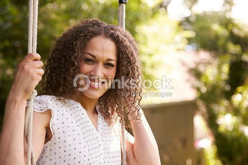 Head And Shoulders Shot Of Mid Adult Woman Sitting : Stock Photo