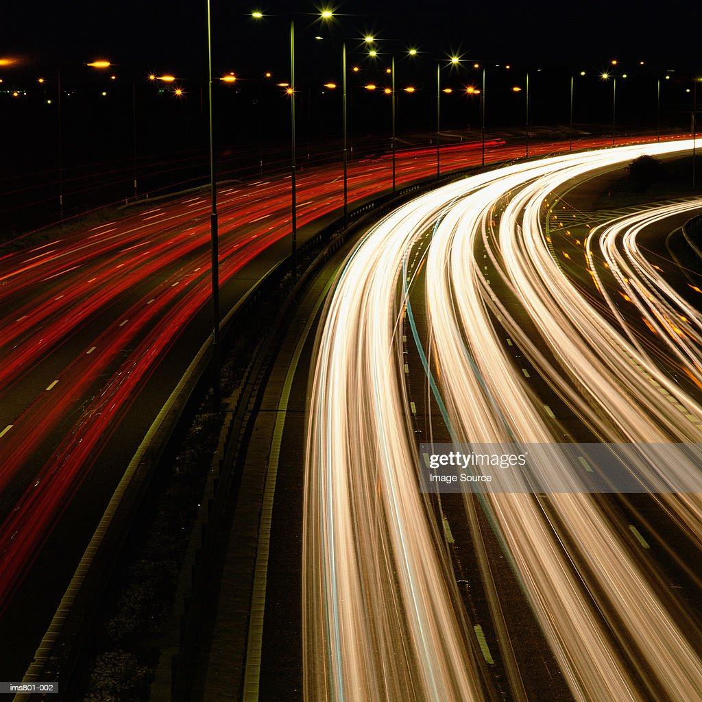 Head and tail-lights on motorway : Stock Photo