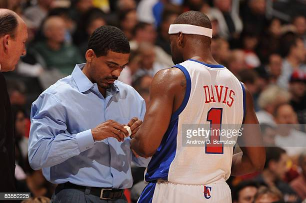 Head athletic trainer Jasen Powell of the Los Angeles Clippers tapes the fingers of Baron Davis during the game against the Utah Jazz at Staples...