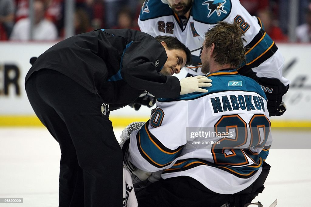 Head Athletic Trainer Ray Tufts of the San Jose Sharks checks on Evgeni Nabokov #20 during the game against the Detroit Red Wings in Game Three of the Western Conference Semifinals during the 2010 Stanley Cup Playoffs at Joe Louis Arena on May 4, 2010 in Detroit, Michigan.