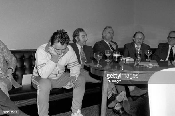 Head bowed sadfaced and dejected Brian Clough hears Mike Bamber next to him Brighton and Hove Albion chairman say that Clough has agreed to stay at...