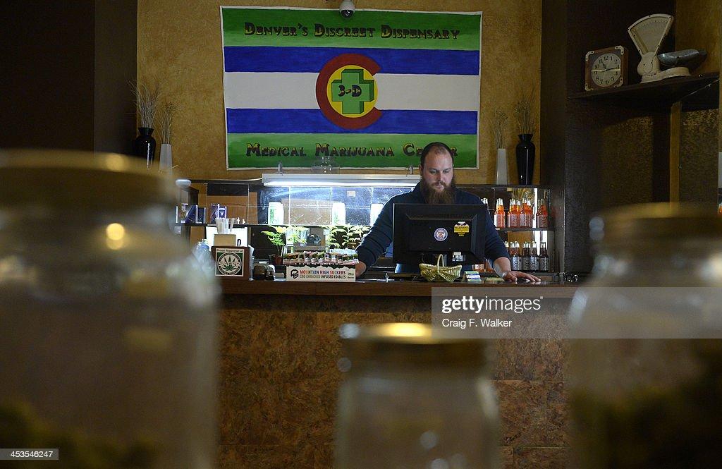 Head Bud Tender Kurt Britz works in the marijuana dispensary at 3-D Denver Discreet Dispensary in Denver, CO December 04, 2013.