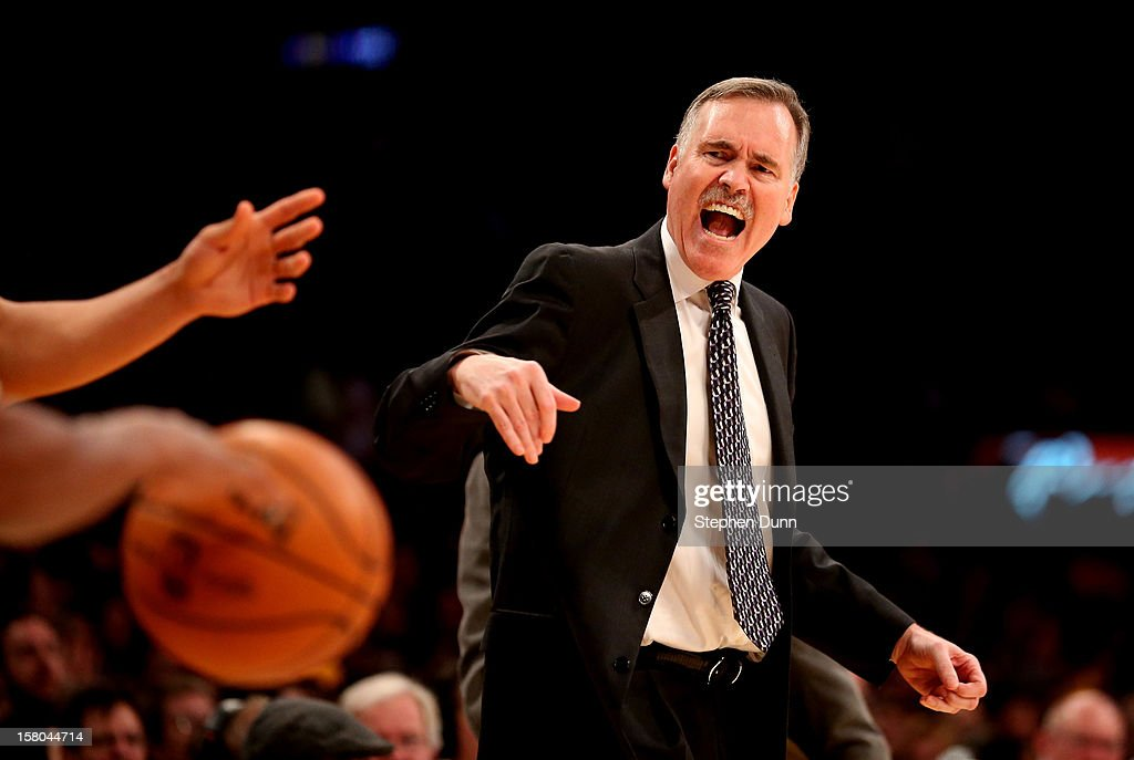 Head caoch Mike D'Antoni of the Los Angeles Lakers complains to a referee during the game against the Utah Jazz at Staples Center on December 9, 2012 in Los Angeles, California. The Jazz won 117-110.
