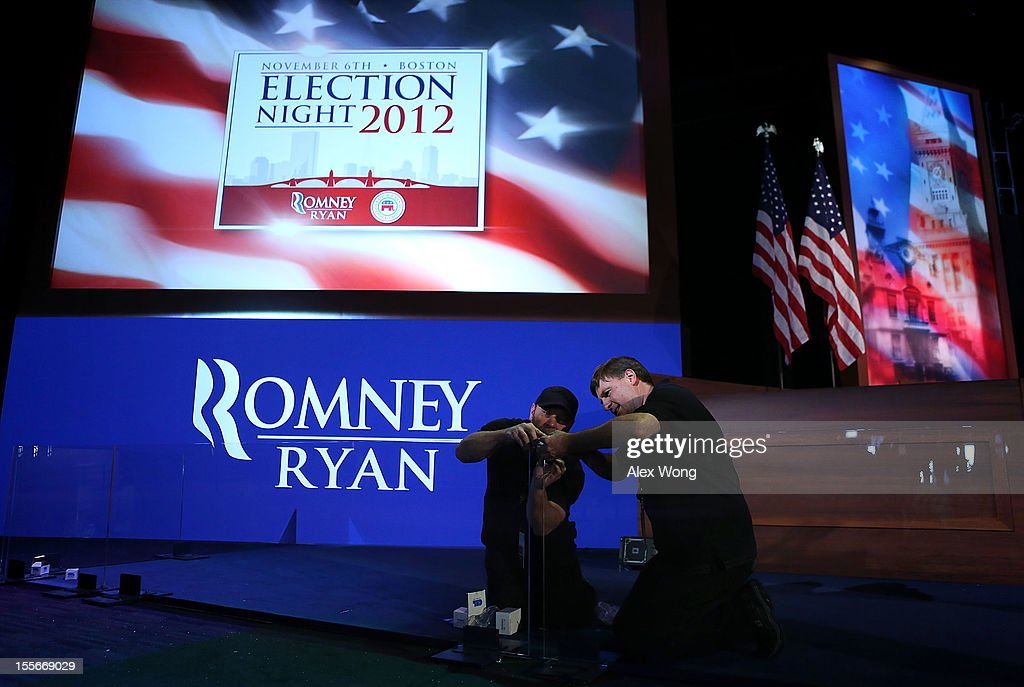 Head Carpenter Tom Higgins (R) of JCALPRO Inc. assembles a plexiglass barricade with his assistant Harry Butts at the Boston Convention and Exhibition Center for Mitt Romney Campaign's election night event November 6, 2012 in Boston, Massachusetts. As Americans go to vote, President Barack Obama and Republican nominee former Massachusetts Gov. Mitt Romney remain in a virtual tie in the national polls.