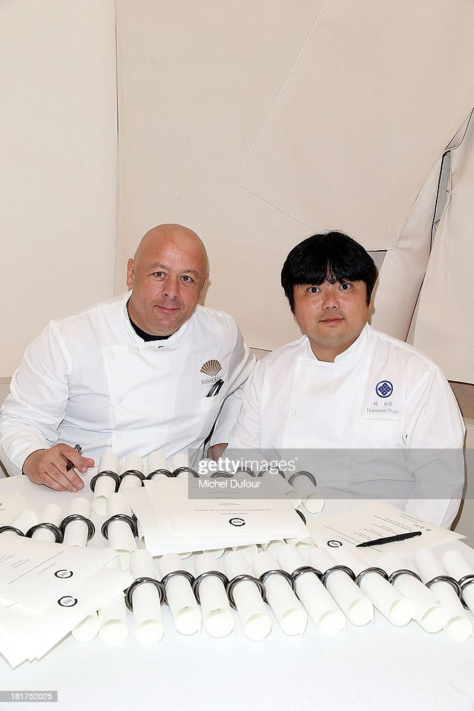 Head chef of the 'Mandarin Oriental' <a gi-track='captionPersonalityLinkClicked' href=/galleries/search?phrase=Thierry+Marx&family=editorial&specificpeople=4584729 ng-click='$event.stopPropagation()'>Thierry Marx</a> and Hagi (R) attend a lunch organised by the 'Club des Chefs des Chefs' in honor of the Japanese Head Chef Hagi from Fukushima at 'Le Mandarin Oriental' restaurant on September 24, 2013 in Paris, France.