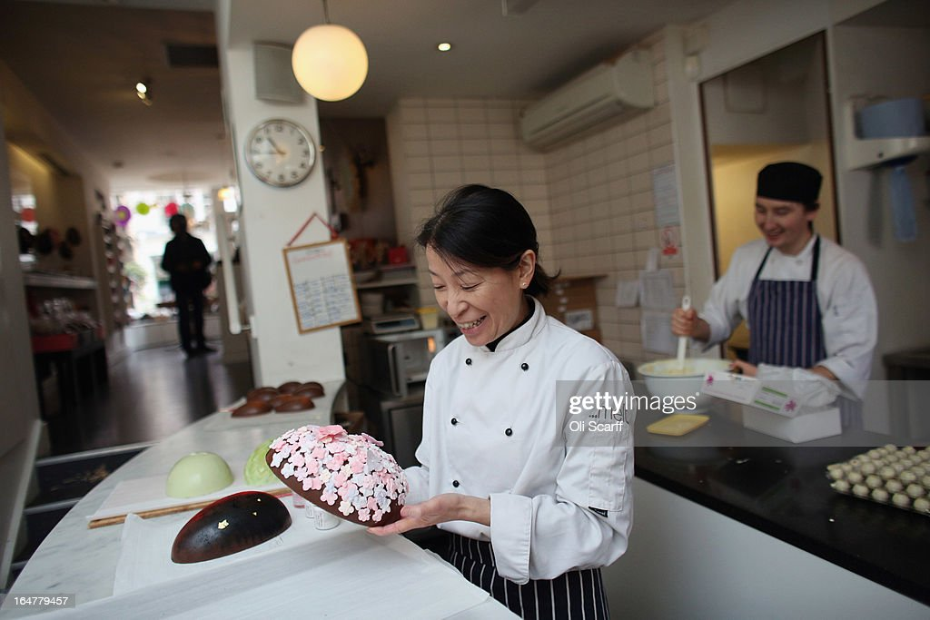 Head chocolatier Chika Watanabe (C) and chocolatier Stephen Glenister create handmade Easter eggs in the 'Melt' chocolate shop in Notting Hill on March 28, 2013 in London, England. Easter represents the busiest time of year for the luxury chocolate retailer 'Melt' who, in addition to their regular customised Easter eggs, also make a range of large themed eggs with a limited edition of 5.