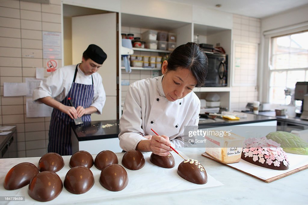 Head chocolatier Chika Watanabe (R) and chocolatier Stephen Glenister create handmade Easter eggs in the 'Melt' chocolate shop in Notting Hill on March 28, 2013 in London, England. Easter represents the busiest time of year for the luxury chocolate retailer 'Melt' who, in addition to their regular customised Easter eggs, also make a range of large themed eggs with a limited edition of 5.
